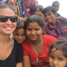 Love this picture of Kimberly with the local children in India.