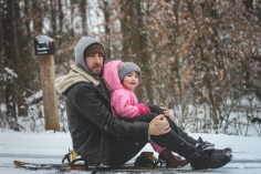 Evelet having fun in the snow with her dad, Jason.